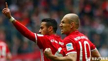 Bayern Munich's Thiago Alcantara celebrates scoring their second goal with Arjen Robben (REUTERS)