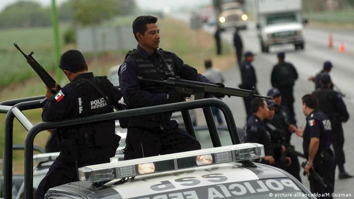 Armed Mexican police on the verge of a highway