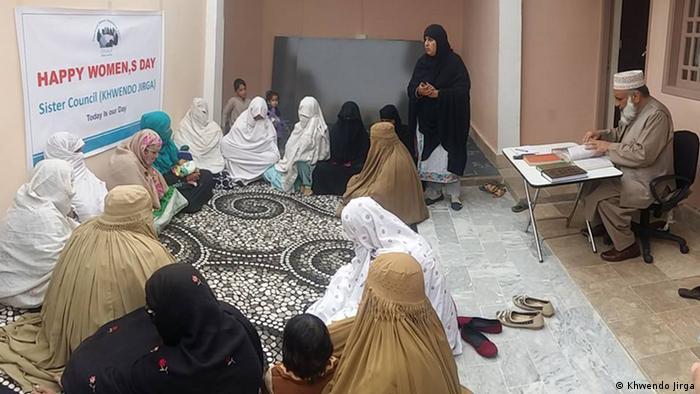 Women in burqas gather at the women's jirga in Swat Valley, Pakistan