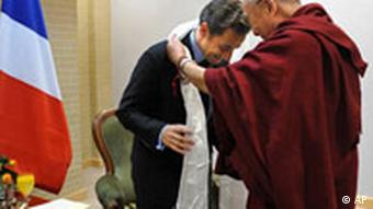 French President Nicolas Sarkozy, left, is welcomed by the Dalai Lama in Gdansk, Poland, Saturday, Dec. 6, 2008