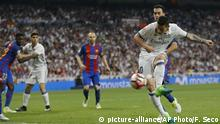 Real Madrid's James Rodriguez scores during a Spanish La Liga soccer match between Real Madrid and Barcelona, dubbed 'el clasico', at the Santiago Bernabeu stadium in Madrid, Spain, Sunday, April 23, 2017. (AP Photo/Francisco Seco)  