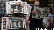 24.04.2017****A man reads the local newspaper near a rack which displays copies of French daily newspapers with front pages about the results in France's Presidential election in Nice, France, April 24, 2017. REUTERS/Eric Gaillard