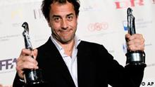 Italian director Matteo Garrone displays the European Director Award and the European Film Award for the movie Gomorra, during the European Film Award 2008 ceremony Saturday Dec. 6, 2008 in Copenhagen, Denmark. Gomorra received a total of five awards during the ceremony, including best cinematographer and best screenwriter. (AP Photo/POLFOTO, Tariq Mikkel Khan) ** DENMARK OUT **