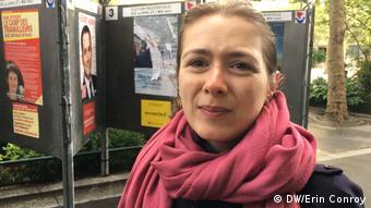 Saleswoman Stephanie Pottier stands on a Paris street