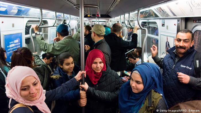 A group of mostly Syrian but some Iraqi refugee families ride the subways during a tour of Manhattan on April 21, 2017 in New York.