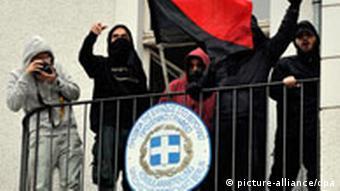 Demonstrators on a balcony of the Greek embassy in Berlin
