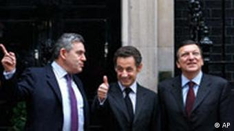 Britain's Prime Minister Gordon Brown, left, meets French President Nicolas Sarkozy, center, and European Commission President Jose Manuel Barroso at 10 Downing Street in London