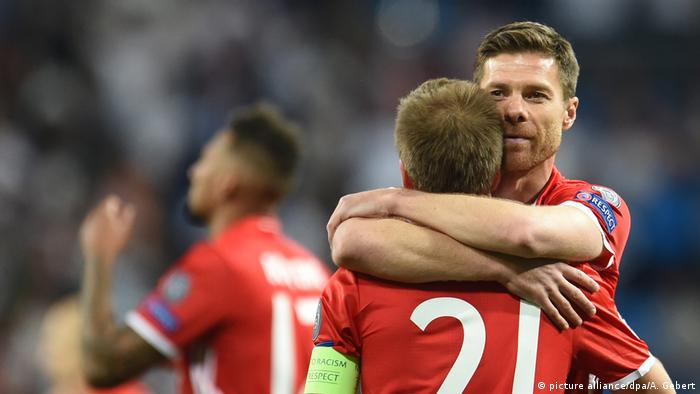 Philipp Lahm and Xabi Alonso