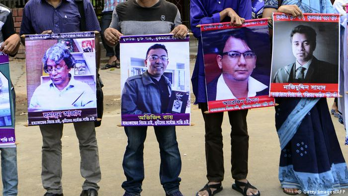 Protesters holding up posters of slain bloggers in Bangaldesh