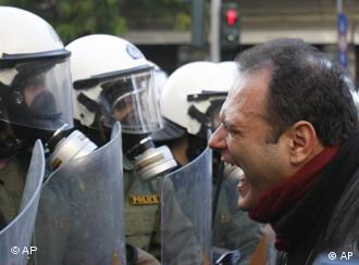 A protester shouts at riot police in central Athens