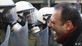 A protester shouts at riot police in central Athens on Tuesday, Dec. 9, 2008. Athens and other Greek cities were ravaged by three successive nights of rioting after police shot teenager Alexandros Grigoropoulos dead. (AP Photo/Petros Karadjias)