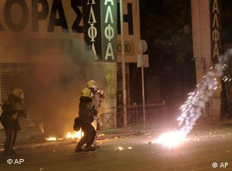 Riot police are attacked with firebombs thrown by rioters