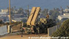 Israeli soldiers are seen next to a Patriot rocket interceptor battery deployed in the northern Israeli city of Haifa, Wednesday, Aug. 28, 2013. Israel ordered a special call-up of reserve troops Wednesday as nervous citizens lined up at gas-mask distribution centers, preparing for possible hostilities with Syria. (AP Photo/Tsafrir Abayov) |