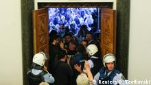 April 27, 2017 Protesters entered Macedonia's parliament after the governing Social Democrats and ethnic Albanian parties voted to elect an Albanian as parliament speaker in Skopje. Macedonia April 27, 2017. REUTERS/Ognen Teofilovski