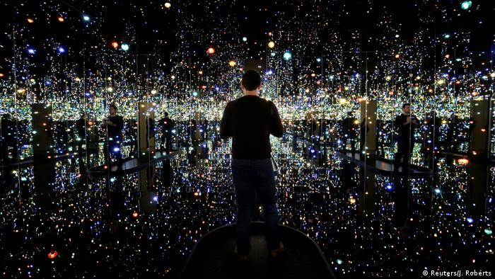 A man views the exhibit Infinity Mirrored Room - The Souls of a Million Light Years Away by Japanese artist Yayoi Kusama at the Hirshhorn Museum in Washington ICYMI (Reuters/J. Roberts)
