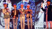 Members of China's all-girl boyband FFC-Acrush appear on the stage during their maiden press conference in Beijing, China April 28, 2017. REUTERS/Damir Sagolj