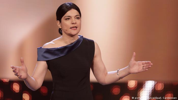 Jasmin Tabatabai holds out her hands onstage