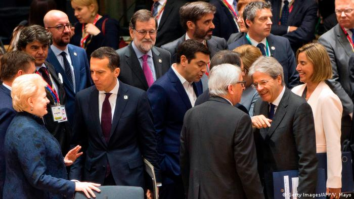 Italy's Prime minister Paolo Gentiloni (2nd R) speaks with European Commission President Jean-Claude Juncker (3rd R) among EU leaders during a special EU leaders' meeting at the Europa building, the main headquarters of European Council and the Council of the EU, in Brussels