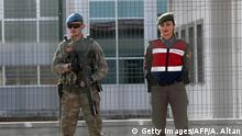 Turkish soldiers guard at the Sincan Prison in Ankara, on February 28, 2017 during the trial of suspects accused of involvement in last year's failed July coup in Turkey. The biggest trial of suspects accused of involvement in last year's failed July coup opened in Ankara on February 28, 2017 in a courtroom specially built to hold more than 1,500 people. Some 330 suspects are being put on trial in Sincan outside the capital Ankara, and if convicted, they face multiple life sentences over their alleged links to the attempted overthrow of President Recep Tayyip Erdogan. The suspects, many of them from the Polatli artillery and missile school command in Ankara, have been charged with murder or attempted murder. / AFP / Adem ALTAN (Photo credit should read ADEM ALTAN/AFP/Getty Images)