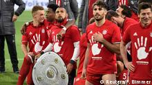 Football Soccer - VFL Wolfsburg v Bayern Munich - Bundesliga - Volkswagen Arena, Wolfsburg, Germany - 29/4/17 Bayern Munich's Arturo Vidal, David Alaba and teammates celebrate after the match after winning the Bundesliga Reuters / Fabian Bimmer Livepic DFL RULES TO LIMIT THE ONLINE USAGE DURING MATCH TIME TO 15 PICTURES PER GAME. IMAGE SEQUENCES TO SIMULATE VIDEO IS NOT ALLOWED AT ANY TIME. FOR FURTHER QUERIES PLEASE CONTACT DFL DIRECTLY AT + 49 69 650050.