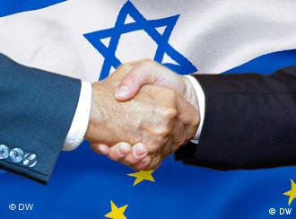 Two men shake hands in front of Israeli and EU flags