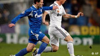 Real Madrid's Guti from Spain, right, vies for the ball with Zenit's Ivica Krizanac from Croatia, left, during their Champions League Group H soccer match at the Santiago Bernabeu stadium in Madrid, Wednesday, Dec. 10