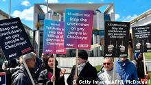 30.04.2017 +++ Activists display placards in front of the Chancellery in Berlin on April 30, 2017, during a demonstration calling on Russian President to put an end to the persecution of gay men in Chechnya. The protestors called on German Chancellor Angela Merkel, who will meet Putin in Sochi on May 2, 2017, to raise the issue with him. / AFP PHOTO / John MACDOUGALL (Photo credit should read JOHN MACDOUGALL/AFP/Getty Images)