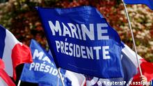 01.05.2017 +++ Supporters for Marine Le Pen, French National Front (FN) political party leader and candidate for French 2017 presidential election, carry flags as they arrive to attend a campaign rally in Paris, France, May 1, 2017. REUTESR/Pascal Rossignol