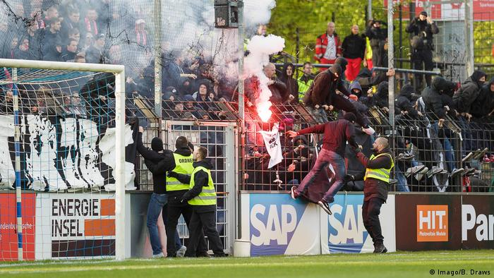 Fireworks set off in the crowd at a Cottbus soccer match