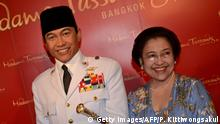 Former Indonesian President Megawati Sukarnoputri (R) poses with a wax statue of her father President Soekarno (L) at Madame Tussauds in Bangkok on September 24, 2012. The wax figure was unveiled at the ceremony, attended by Indonesia's fifth President and Soekarno's daughter, Megawati Soekarnoputri. AFP PHOTO/PORNCHAI KITTIWONGSAKUL (Photo credit should read PORNCHAI KITTIWONGSAKUL/AFP/GettyImages)
