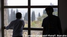 Oct. 11, 2016. Migrant children stand on the window of a new reception center for unaccompanied minors in Athens, Tuesday, Oct. 11, 2016. The Balkan route, used by nearly 1 million migrants last year to cross to mainland Europe, was closed last March and over 60,000 people are stranded in Greece. (AP Photo/Thanassis Stavrakis) |