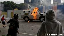 03.05.2017+++ An armored police vehicle is hit by petrol bombs thrown by opposition supporters while clashing with riot police during a rally against President Nicolas Maduro in Caracas, Venezuela May 3, 2017. REUTERS/Marco Bello