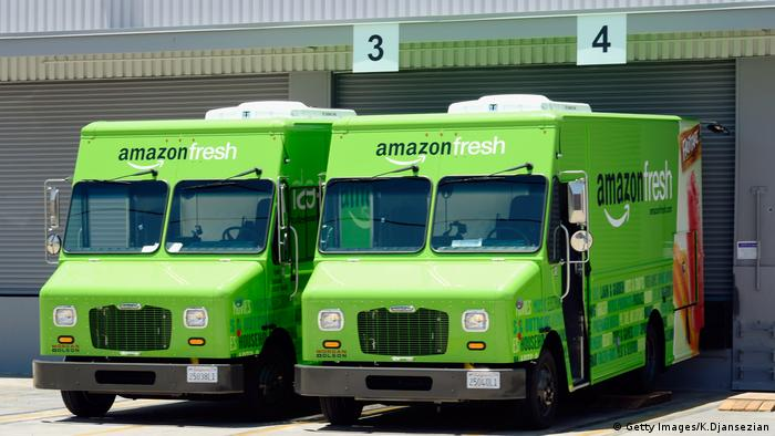 Amazon Fresh trucks parked at a warehouse on in Inglewood, California.