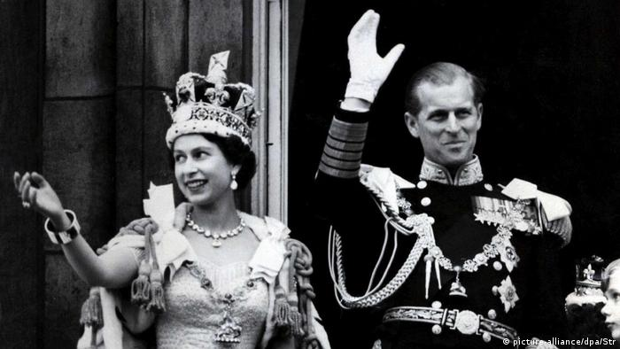 Prince Philip and the Queen wave after her official coronation