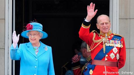 Queen Elizabeth and Prince Philip wave here from the balcony of Buckingham Palace. (Reuters/K. Doherty)