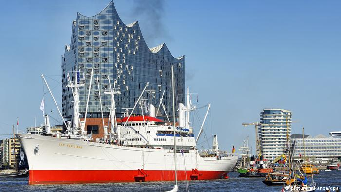 A ship sails past the Elbphilharmonie concert hall during the annual ship parade in Hamburg.
