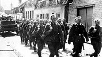German troops march into the French city of Dunkirk in 1940
