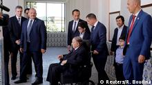 Algeria's President Abdelaziz Bouteflika (seated) is pictured after casting his ballot during the parliamentary election in Algiers, Algeria May 4, 2017. REUTERS/Ramzi Boudina