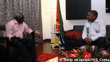 Mozambiques President Filipe Nyusi (R) meets with opposition leader Afonso Dhlakama (L) on February 7, 2015 in Maputo, Mozambique. Nyusi opened talks with Dhlakama in a bid to calm a volatile political situation after the opposition rejected the results of an October election. It is the first time the two are meeting face-to-face since Nyusi took the reins of power in the coal and gas rich southern African country last month. AFP PHOTO /SERGIO COSTA (Photo credit should read Sergio Costa/AFP/Getty Images)