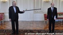 04.05.2017 Czech President Milos Zeman, left, points his stick as Czech Prime Minister Bohuslav Sobotka prior to their meeting in Prague on Thurday, May 4, 2017. Sobotka arrived at Prague Castle, the seat of the presidency, on Thursday for consultations with the president following his decision to resign with his government over the business dealings of his finance minister. (Michal Dolezal/CTK via AP) |