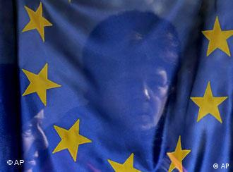 EU flag with face of woman behind