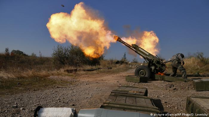 Separatists fire artillery at the Ukrainian military's position at the Donetsk airport