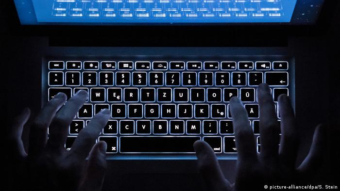 A person types on a keyboard