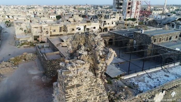 A Syrian neighborhood of flat-roofed houses that have been heavily bombed.