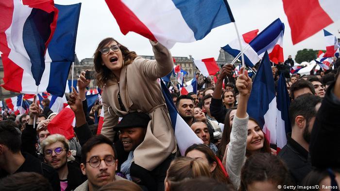 People celebrate Emmanuel Macron's election victory in France