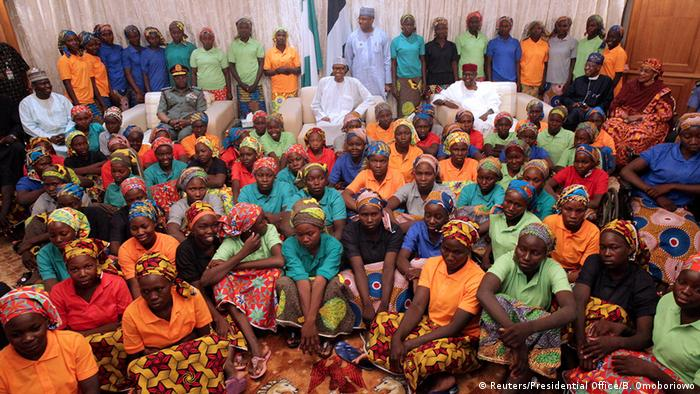 Nigeria's President Muhammadu Buhari smiles as he welcomes a group of Chibok girls, who were held captive for three years by the millitant group Boko Haram (Reuters/Presidential Office/B. Omoboriowo)