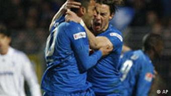 Matthias Jaissle from Hoffenheim, right, celebrates scorer Selim Teber, left, during the German first division Bundesliga soccer match between 1899 Hoffenheim and Schalke 04 in Mannheim, southwestern Germany, on Sunday, Dec. 14, 2008. (AP Photo/Daniel Roland) ** NO MOBILE USE UNTIL 2 HOURS AFTER THE MATCH, WEBSITE USERS ARE OBLIGED TO COMPLY WITH DFL-RESTRICTIONS, SEE INSTRUCTIONS FOR DETAILS **