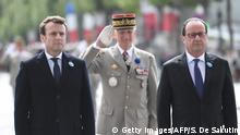 08.05.2017****Outgoing French president Francois Hollande (R) and French president-elect Emmanuel Macron (L) attend the ceremony marking the 72nd anniversary of the victory over Nazi Germany during WWII on May 8, 1945 under the Arc de Triomphe monument in Paris on May 8, 2017. / AFP PHOTO / POOL / STEPHANE DE SAKUTIN (Photo credit should read STEPHANE DE SAKUTIN/AFP/Getty Images)