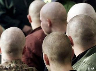 a group of neo-nazis with shaved heads
