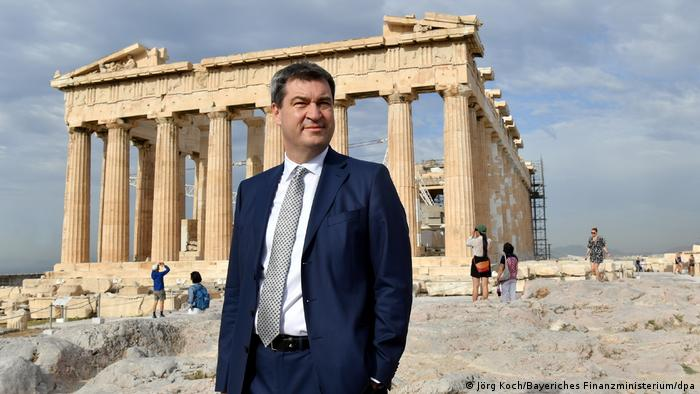 Bavarian Finance Minister Markus Söder standing in front of the Acropolis